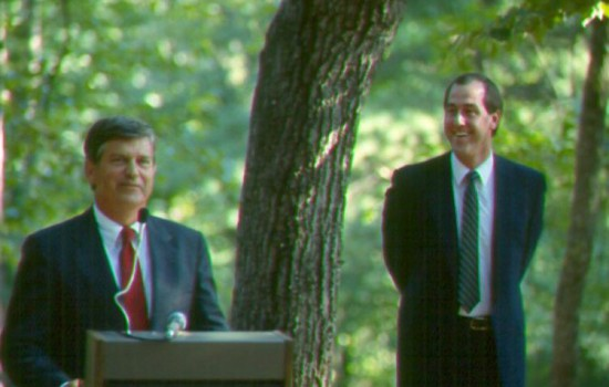 Governor Jim Martin addresses a group in August 1987 as newly hired Executive Director George Briggs looks on.