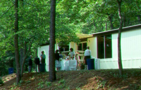 The North Carolina Arboretum, an affiliate of the University of North Carolina system began in humble office dwellings - a bank branch trailer donated by Asheville Savings Bank -  at the historic Bent Creek Demonstration historic headquarters.