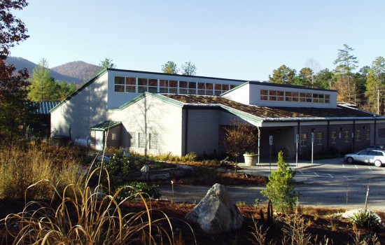 The Operations Center, one of the first high-performance green buildings in North Carolina state government, opens as a hub for maintenance and horticulture departments in 2004.